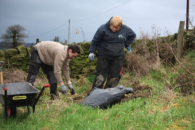 Volunteers from the Steel Valley Project planting Tree 19