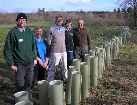 Tree tubes and members of Horsham Green Gym