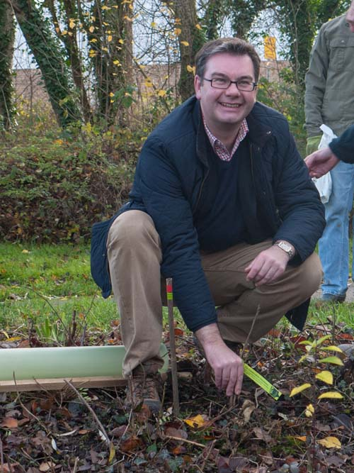 Iain Stewart planting his first ever tree