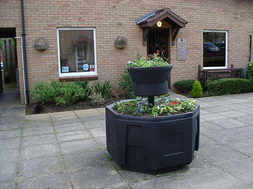 One of the planters – surrounding slabs cleaned up by the volunteers.