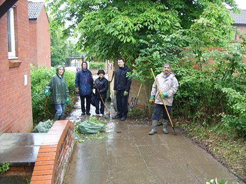 During - five very wet volunteers working on these two areas