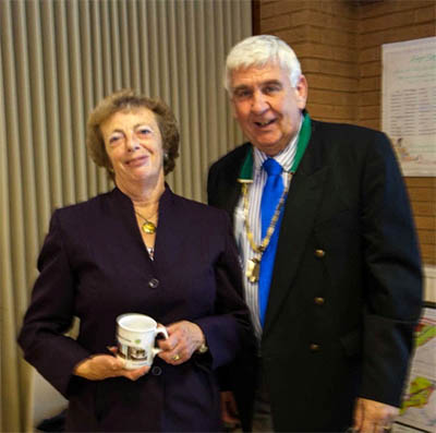 Mary Parker receiving a Four Seasons mug from the Deputy Mayor Cllr Keith McLean